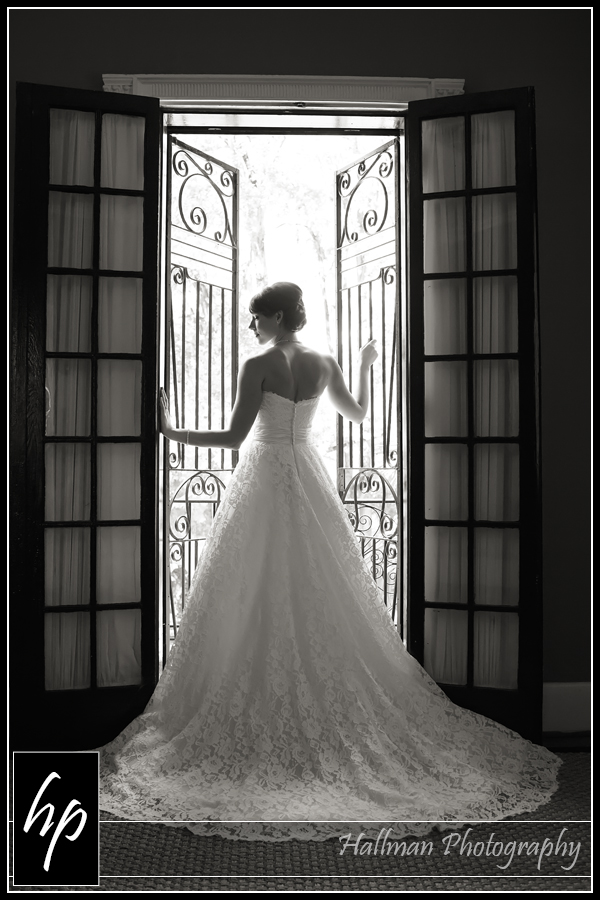 Bride at window at The Millstone at Adam's Pond