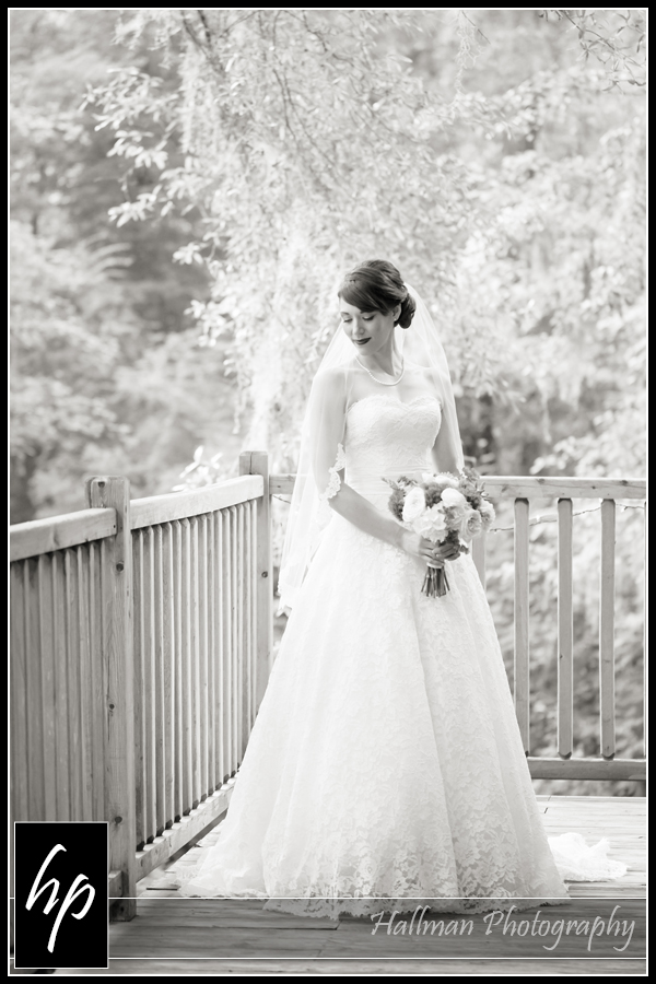 Bride on back porch at The Millstone at Adam's Pond