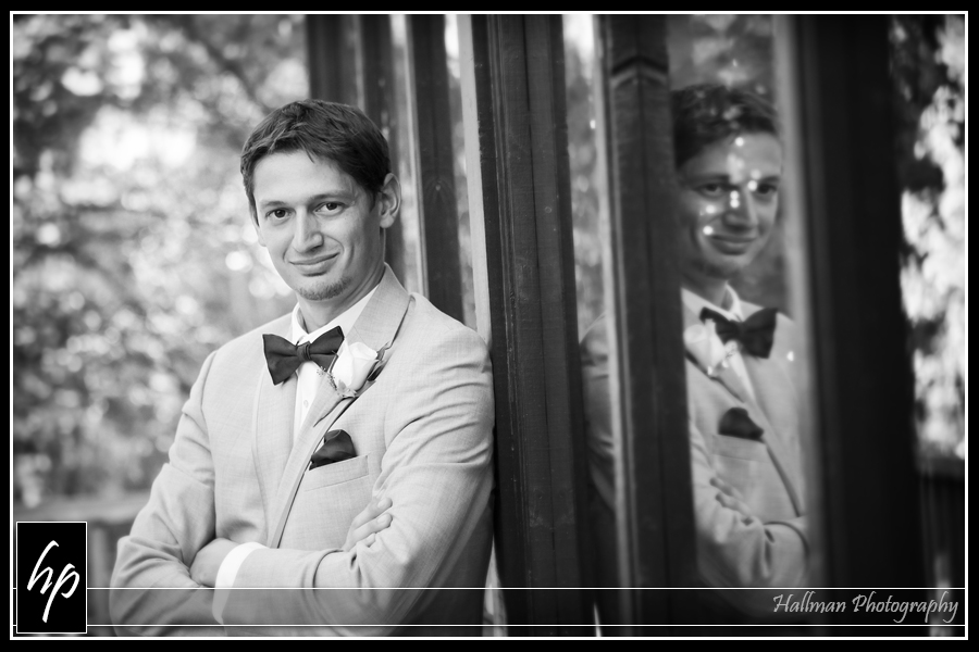 Groom on back porch at The Millstone at Adams Pond