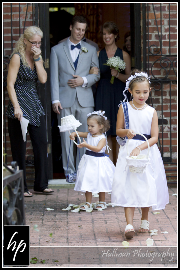 flower girls with little one dumping flower basket