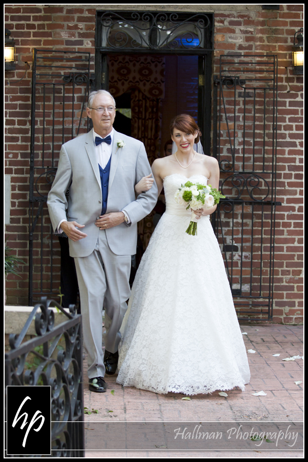 bride and her dad coming down aisle